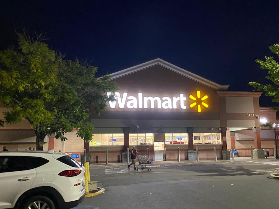 The exterior of a walmart from the parking lot