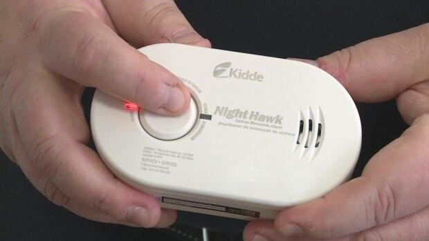 Carbon monoxide alarms, which could look like this battery-operated one, will be required in all residential buildings in the province.  (Laura Meader/CBC - image credit)