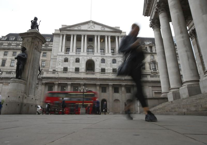 Commuters walk past the Bank of England in London