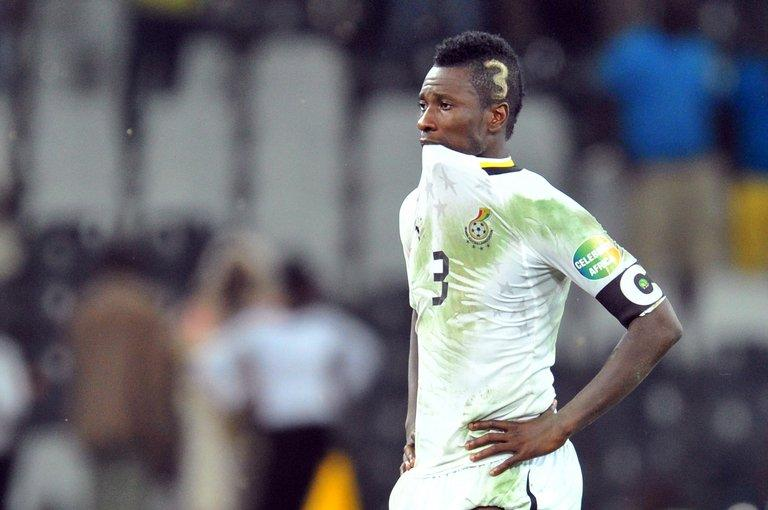 Ghana forward Asamoah Gyan cuts a dejected figure after his side went out on penalties in the semi-final of the Africa Cup of Nations, against Burkina Faso, on February 6, 2013. Ghana face Mali on Saturday for third place