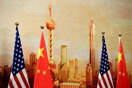 U.S. and Chinese flags are placed for a joint news conference by U.S. Secretary of State Mike Pompeo and Chinese Foreign Minister Wang Yi at the Great Hall of the People in Beijing, China June 14, 2018. REUTERS/Jason Lee/File Photo