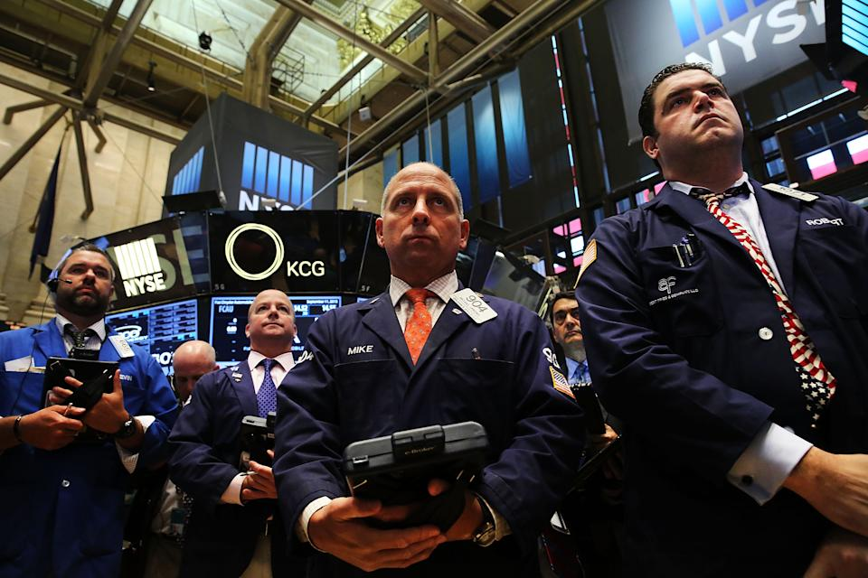 NEW YORK, NY - SEPTEMBER 11:  Traders on the floor of the New York Stock Exchange participate in a moment of silence in remembrance of the events of September 11, 2001 on September 11, 2015 in New York City.  Throughout the nation people are holding somber gatherings and memorial events to reflect on the 14-year anniversary of the 9/11 attacks that resulted in the loss of nearly 3,000 people.  (Photo by Spencer Platt/Getty Images)