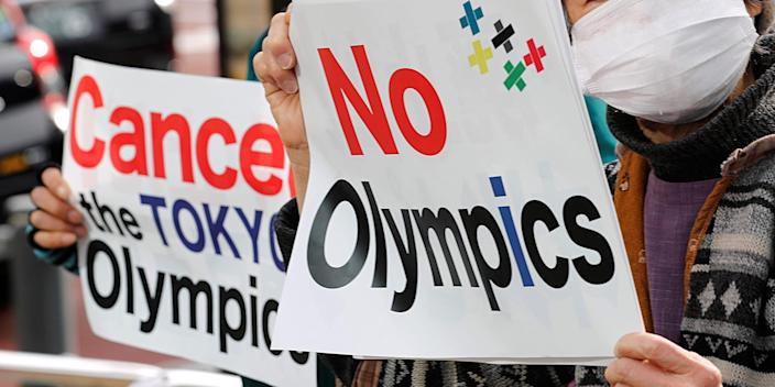 Protesters hold a rally in front of a building housing the Organising Committee of the 2020 Tokyo Olympic Games to demand the Games' cancellation in Tokyo, Japan, February 12, 2021.