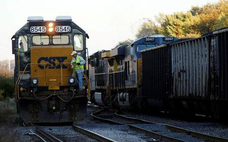 FILE PHOTO: A CSX coal train moves past an idling CSX engine at the switchyard in Brunswick, Maryland