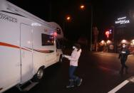 Customers enjoy dinner sitting inside a motorhome camper parked at the Belgian restaurant Matthias And Sea in Tarcienne