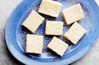 """These classic bars are as as refreshing as an icy glass of lemonade. Bring a platter to your Memorial Day picnic. <a href=""""https://www.epicurious.com/recipes/food/views/carnation-lemon-bars?mbid=synd_yahoo_rss"""" rel=""""nofollow noopener"""" target=""""_blank"""" data-ylk=""""slk:See recipe."""" class=""""link rapid-noclick-resp"""">See recipe.</a>"""