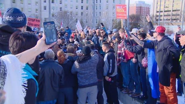 Anti-lockdown protesters surrounded police during scuffles at a rally on the Alberta legislature grounds on Saturday. (Scott Neufeld/CBC News - image credit)