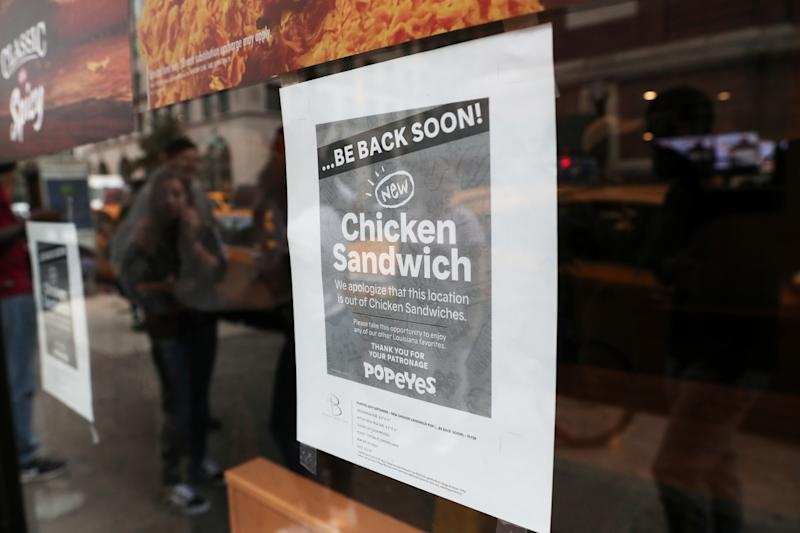 A sign posted outside Popeyes Louisiana Kitchen states that the restaurant is out of their new chicken sandwiches in New York, U.S., August 23, 2019. REUTERS/Shannon Stapleton