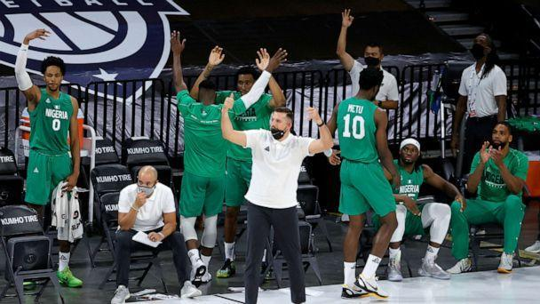 PHOTO: The Nigeria bench reacts after Ike Iroegbu #1 of Nigeria hit a 3-pointer against the United States in the fourth quarter of an exhibition game at Michelob ULTRA Arena ahead of the Tokyo Olympic Games, July 10, 2021, in Las Vegas. (Ethan Miller/Getty Images)
