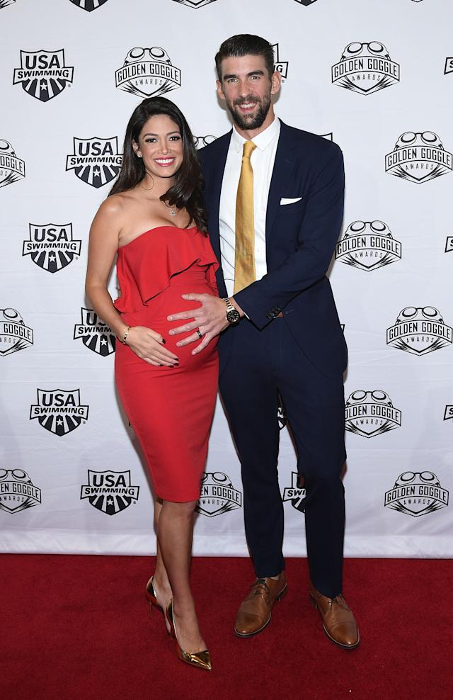 Swimmer Michael Phelps and his wife, Nicole Johnson, attend the 2017 USA Swimming Golden Goggle Awards in November 2017. (Photo: Getty Images)