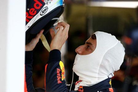 Formula One - F1 - Australian Grand Prix - Melbourne, Australia - 25/03/2017 Red Bull Racing driver Daniel Ricciardo of Australia dons his helmet during the third practice session. REUTERS/Brandon Malone