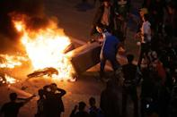 Migrants clashed with Moroccan forces guarding the border overnight Wednesday, as tensions rise between Madrid and Rabat