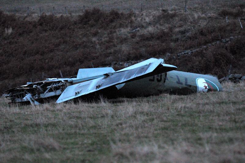 Part of the wreckage of an Algerian military cargo plane which crashed in Trelans, southern France, Friday, Nov. 9, 2012. The plane went down with six people aboard, according to local police. The military cargo plane had taken off from Paris and was returning to Algeria. (AP Photo/Eva Koord) FRANCE OUT