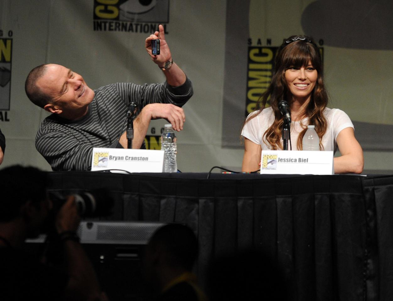 """SAN DIEGO, CA - JULY 13:  Actors Bryan Cranston (L) and Jessica Biel speak during Sony's """"Total Recall"""" panel during Comic-Con International 2012 at San Diego Convention Center on July 13, 2012 in San Diego, California.  (Photo by Kevin Winter/Getty Images)"""