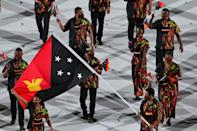Papua New Guinea's Loa Dika Toua (fromt left) at the opening ceremony on Friday. Just hours later she made weightlifting history