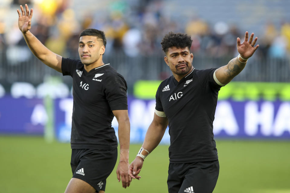 New Zealand's Rieko Ioane, left, and Ardie Savea wave to the crowd following the Rugby Championship game between the All Blacks and the Wallabies in Perth, Australia, Sunday, Sept. 5, 2021. (AP Photo/Gary Day)