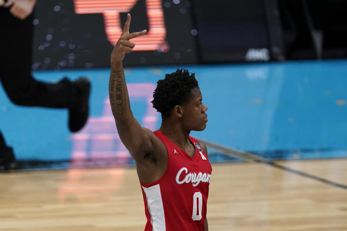 Houston guard Marcus Sasser (0) celebrates a 3-point basket during the first half of a men's Final Four NCAA college basketball tournament semifinal game against Baylor, Saturday, April 3, 2021, at Lucas Oil Stadium in Indianapolis. (AP Photo/Michael Conroy)