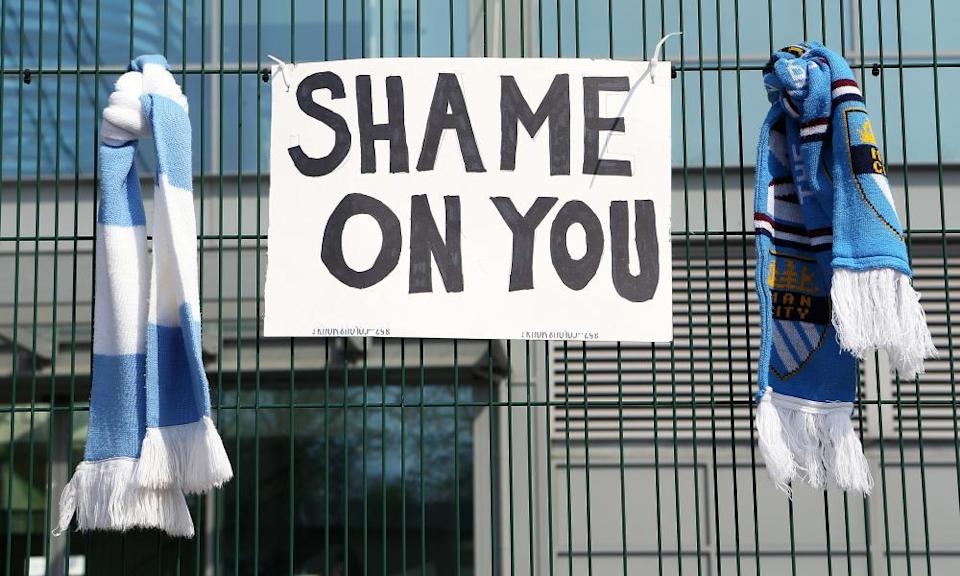 A sign between two Manchester City scarves outside the Etihad Stadium.