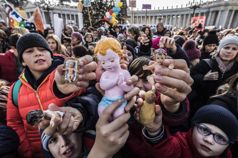 Following a custom started by the late Pope John Paul II, Pope Francis blessed Nativity figurines brought by pilgrims on Dec.17, 2017 at the Vatican. (Alessandra Benedetti - Corbis via Getty Images)