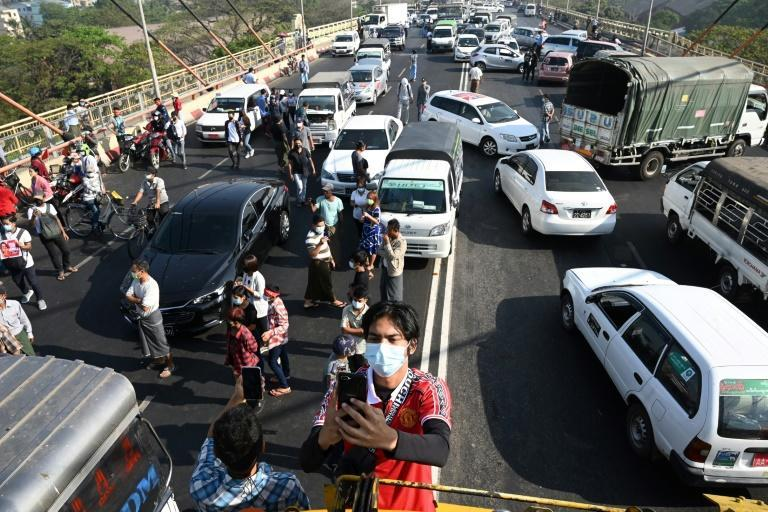 Protesters block a bridge with their cars during a demonstration against the military coup in Yangon