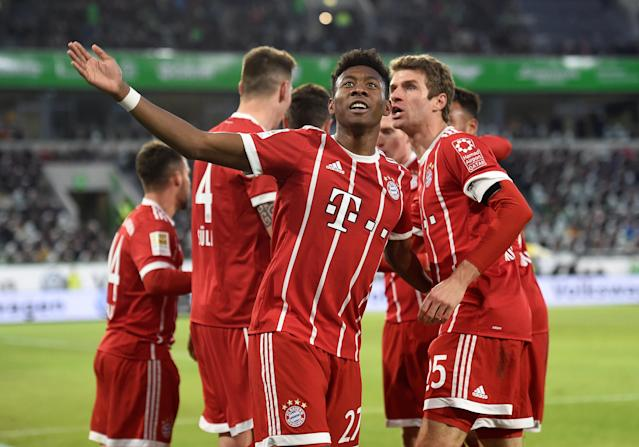 Soccer Football - Bundesliga - VfL Wolfsburg vs Bayern Munich - Volkswagen Arena, Wolfsburg, Germany - February 17, 2018 Bayern Munich's Thomas Muller celebrates their second goal with David Alaba REUTERS/Fabian Bimmer DFL RULES TO LIMIT THE ONLINE USAGE DURING MATCH TIME TO 15 PICTURES PER GAME. IMAGE SEQUENCES TO SIMULATE VIDEO IS NOT ALLOWED AT ANY TIME. FOR FURTHER QUERIES PLEASE CONTACT DFL DIRECTLY AT + 49 69 650050