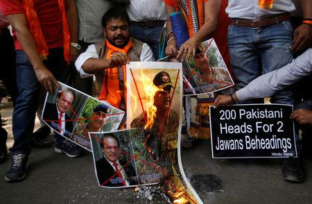 Members of Hindu Sena, a right wing Hindu group, burn posters of Pakistan's Prime Minister Nawaz Sharif and Pakistan's army chief Lieutenant General Qamar Javed Bajwa during a protest in New Delhi, India, May 2, 2017, against the killing of two Indian soldiers who were patrolling the de facto border in the disputed Kashmir region on Monday. REUTERS/Adnan Abidi