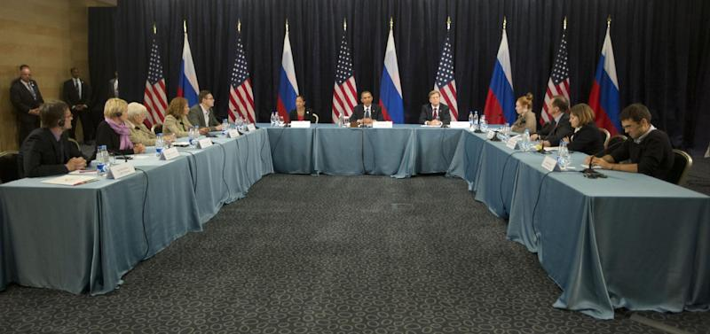 "President Barack Obama participates in a ""Civil Society Roundtable"" with gay, lesbian, bisexual and transgender activists, Friday, Sept. 6, 2013, in St. Petersburg, Russia. (AP Photo/Pablo Martinez Monsivais)"