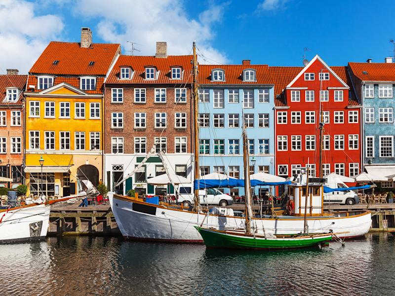 Colourful houses along a canal in Copenhagen: Getty/iStock