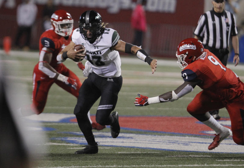 Hawaii quarterback Cole McDonald tries to get past Fresno State defensive lineman Jeff Allison during the second half of an NCAA college football game in Fresno, Calif., Saturday, Oct. 27, 2018. Fresno State won 50-20. (AP Photo/Gary Kazanjian)