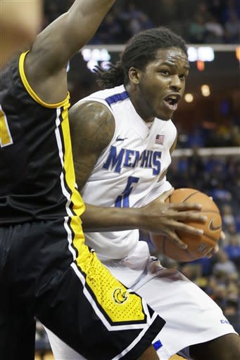 Memphis' Shaq Goodwin (5) is pressured during the first half of an NCAA basketball game against Southern Miss in Memphis, Tenn., Saturday, Feb. 23, 2013. (AP Photo/Danny Johnston)