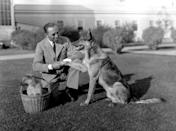 <p>We're not sure who's the star in this photo—director Chester Franklin or his German Shepard, named Peter the Great, who's shaking Chester's hand on the lawn in front of his studio. </p>