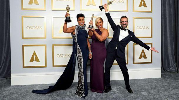 PHOTO: Mia Neal, Jamika Wilson and Sergio Lopez-Rivera, winners of the award for Best Makeup and Hairstyling for 'Ma Rainey's Black Bottom' pose in the press room at the Oscars, in Los Angeles, April 25, 2021.  (Pool/Reuters)