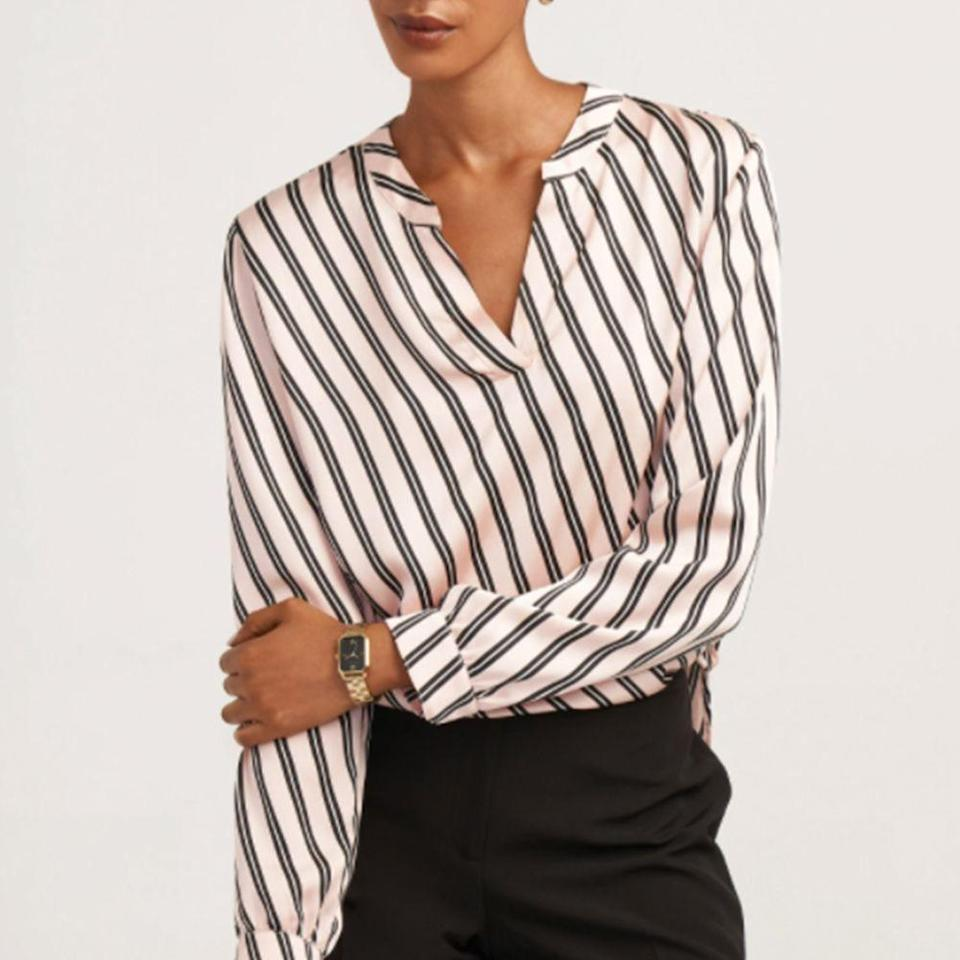 """<p><strong>Anne Klein</strong></p><p>anneklein.com</p><p><strong>$79.00</strong></p><p><a href=""""https://anneklein.com/products/bias-stripe-split-neck-long-sleeve-blouse"""" rel=""""nofollow noopener"""" target=""""_blank"""" data-ylk=""""slk:Shop Now"""" class=""""link rapid-noclick-resp"""">Shop Now</a></p><p>For a professional look, go with this Anne Klein long-sleeved blouse. Perfect for all those Zoom calls! It has a silky smooth texture and a flattering V-neck design. This year, the brand announced that they will donate $10,000 to BCRF in order to fight the good fight. </p>"""
