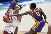 Arkansas' Moses Moody (5) drives against LSU's Josh LeBlanc Sr. (11) in the second half of an NCAA college basketball game in the Southeastern Conference Tournament Saturday, March 13, 2021, in Nashville, Tenn. (AP Photo/Mark Humphrey)
