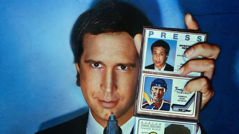 Chevy Chase on the poster for 'Fletch'. (Credit: Universal)