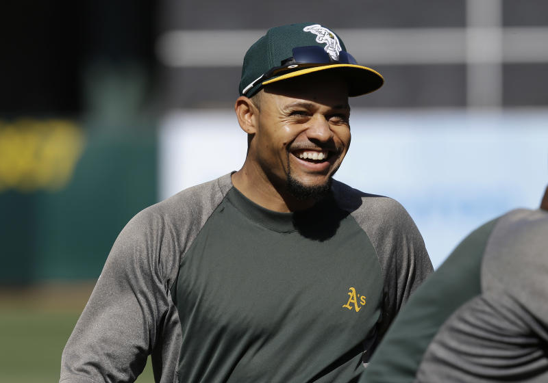 CORRECTS TO DIVISION SERIES, INSTEAD OF CHAMPIONSHIP SERIES - Oakland Athletics' Coco Crisp smiles during baseball batting practice before Game 5 of an AL division series against the Detroit Tigers in Oakland, Calif., Thursday, Oct. 10, 2013. (AP Photo/Ben Margot)