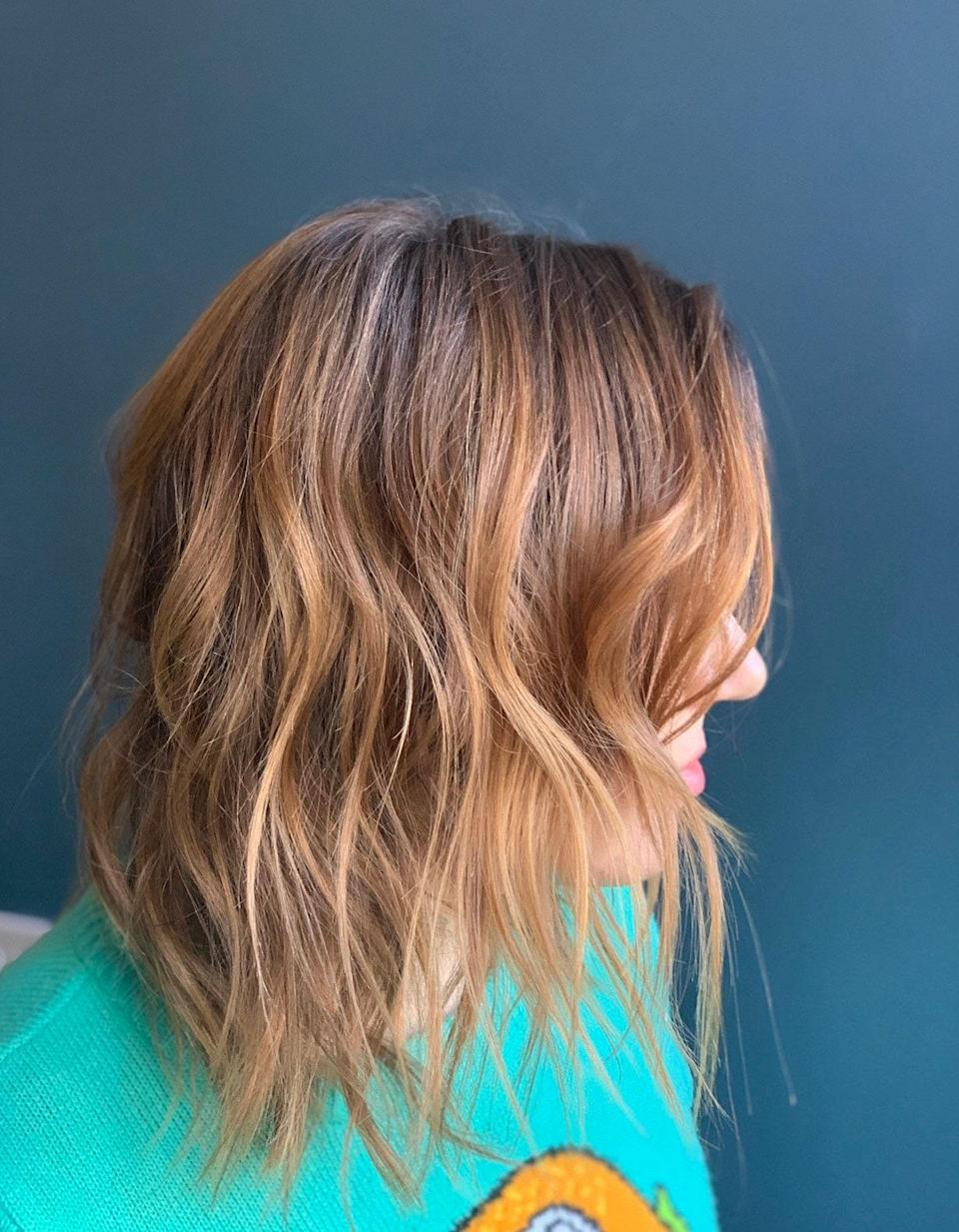 "Look at that, another red shade. ""This is one of my favorite picks for fall,"" says Grummel. ""It works for so many people, in some lighting the color looks blonder, sometimes it's more strawberry."" Ask for some balayage highlights with a little warmth."
