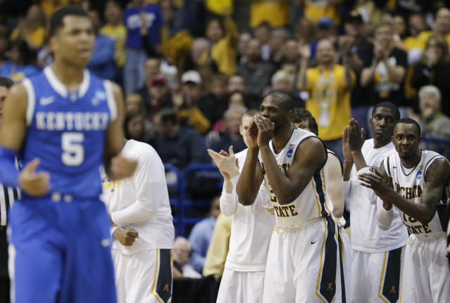 Wichita State cheers against Kentucky during the first half of a third-round game of the NCAA college basketball tournament Sunday, March 23, 2014, in St. Louis. (AP Photo/Charlie Riedel)