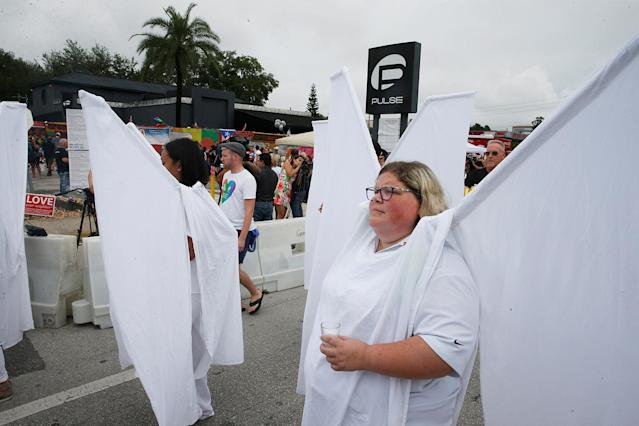 <p>The Pulse Angels march to the memorial outside the Pulse Nightclub on the one-year anniversary of the shooting in Orlando, Florida, June 12, 2017. (Scott Audette/Reuters) </p>