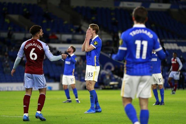 Dan Burn, centre, reacts to Martinez's save which denied his first Brighton goal