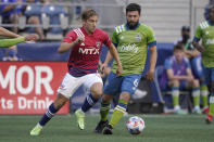 FC Dallas midfielder Paxton Pomykal, left, kicks the ball past Seattle Sounders midfielder Joao Paulo (6) during the first half of an MLS soccer match Wednesday, Aug. 4, 2021, in Seattle. (AP Photo/Ted S. Warren)