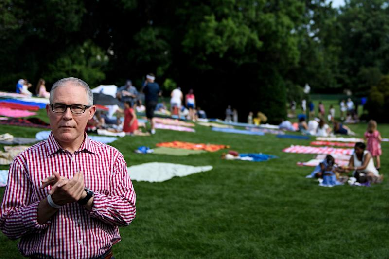 Now former EPA Administrator Scott Pruitt at the White House during a Fourth of July picnic for military families. His dismantling of environmental regulations will continue in his absence, likely with far less of the scrutiny that his notoriety invited. (Brendan Smialowski / Getty Images)
