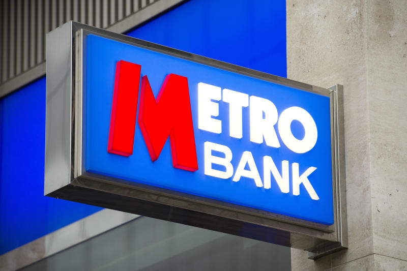 File photo dated 14/02/15 of a Metro Bank sign as founder and chairman Vernon Hill has stepped down with immediate effect following a difficult year for the troubled lender.