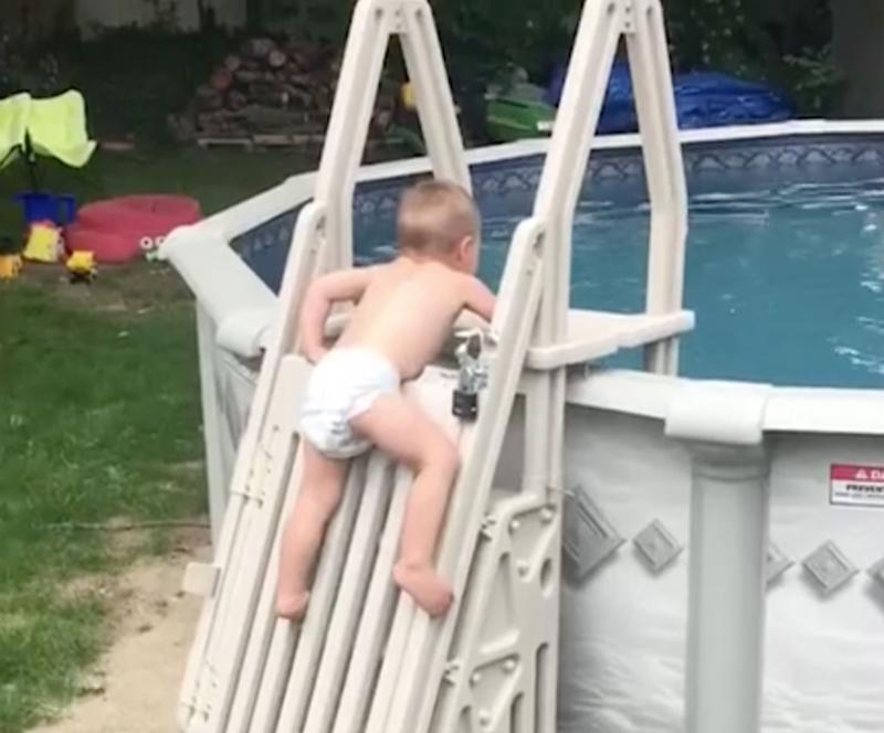 Child scales 'un-climbable' pool ladder in viral video