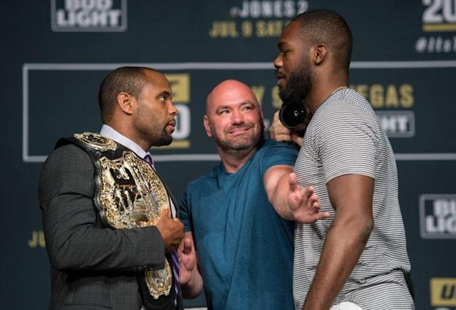 UFC president Dana White has to separate champion Daniel Cormier and then-interim champ Jon Jones at a news conference for UFC 200. (Getty Images)