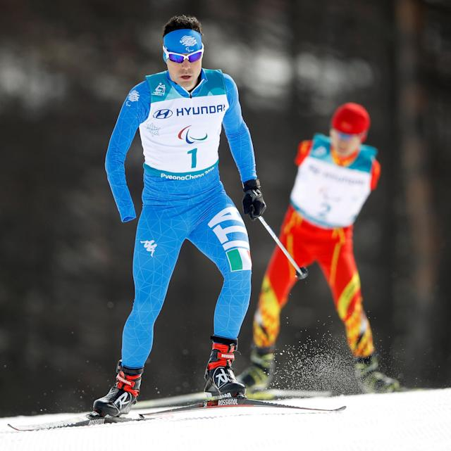 Cross-Country Skiing - Pyeongchang 2018 Winter Paralympics - Men's 20km Free - Standing - Alpensia Biathlon Centre - Pyeongchang, South Korea - March 12, 2018 - Cristian Toninelli of Italy and Wang Chenyang of China compete. REUTERS/Carl Recine