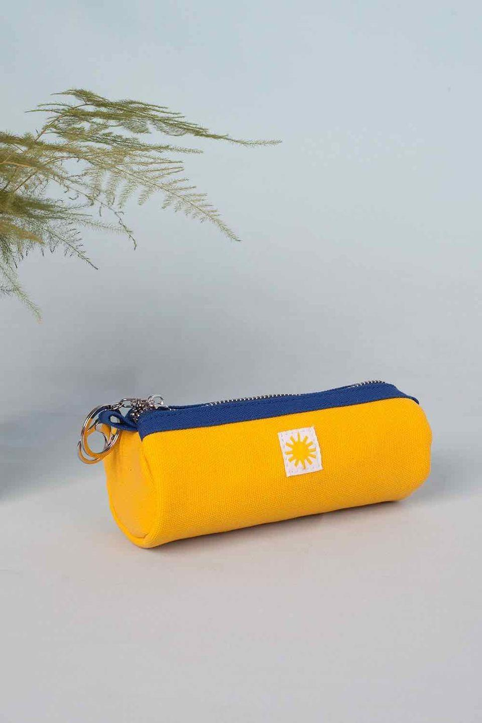 """<p>Hip east London-based clothiers LF Markey, known for its chic utilitarian garments, has applied its winning aesthetic to this sunny pencil case that will brighten up even the most dull work day. £12, <a href=""""https://lfmarkey.com/products/yellow-pencil-case"""" rel=""""nofollow noopener"""" target=""""_blank"""" data-ylk=""""slk:lfmarkey.com"""" class=""""link rapid-noclick-resp"""">lfmarkey.com</a></p>"""