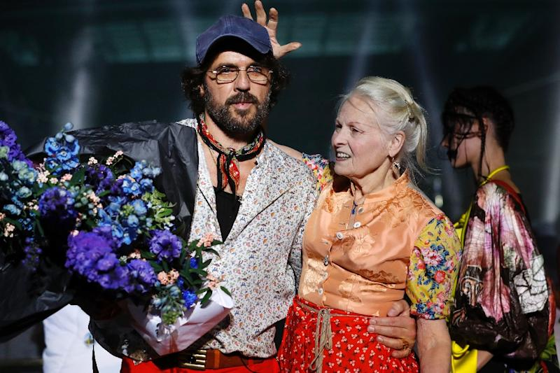 Fashion designer Vivienne Westwood and husband Andreas Kronthaler greet their audience at Paris Fashion Week
