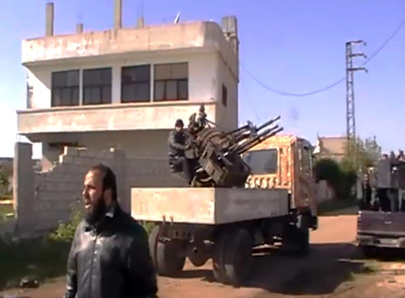 In this Thursday March 28, 2013 image taken from video obtained from the Shaam News Network, which has been authenticated based on its contents and other AP reporting, shows Syrian Free Army fighters in Dael less than 15 kilometers (10 miles) from the Jordanian border in Daraa province, Syria. Syrian rebels on Friday captured a strategic town near the border with Jordan after a day of fierce clashes that killed at least 38 people, activists said, as opposition fighters expand their presence in the south, considered a gateway to Damascus. (AP Photo/Shaam News Network via AP video)
