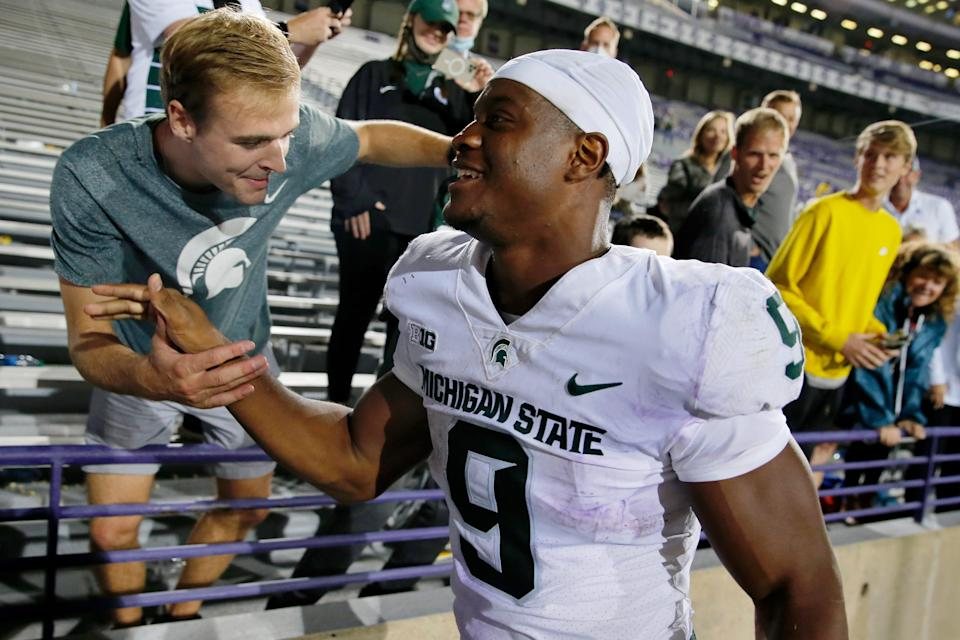 Michigan State Spartans running back Kenneth Walker III celebrates their victory with fans after the game at Ryan Field. The Michigan State Spartans won 38-21 on Friday, Sept. 3, 2021.